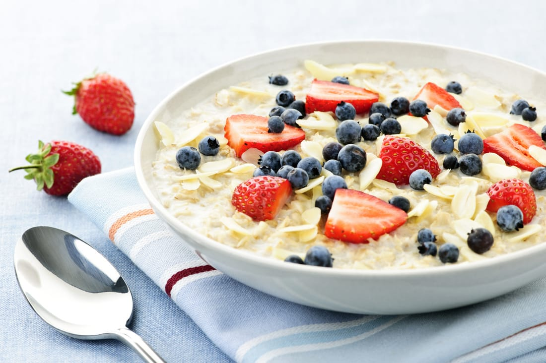 Bowl of oatmeal with blueberries and strawberries